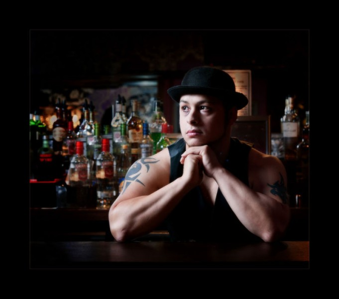Fashion photographers glasgow bar tender in a hat