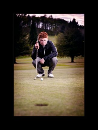 Sport photographers glasgow golfer lining up the hole for putt
