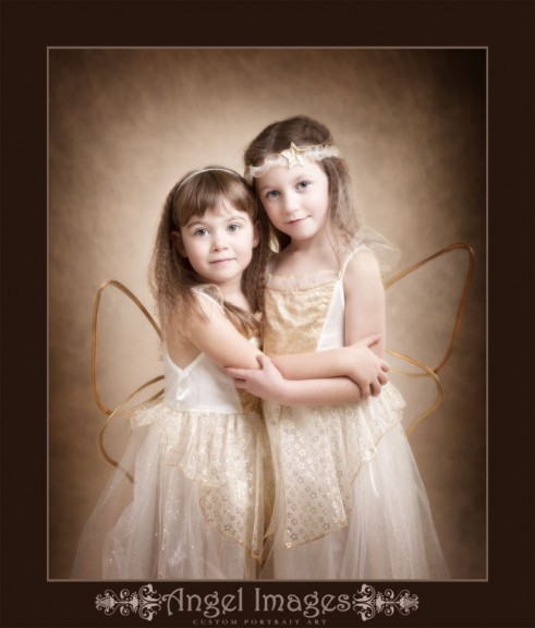 Sisters in Xmas angel outfits shot by greenock photographer angel images