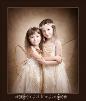 Glasgow photographers Sisters in Xmas angel outfits shot by greenock photographer angel images