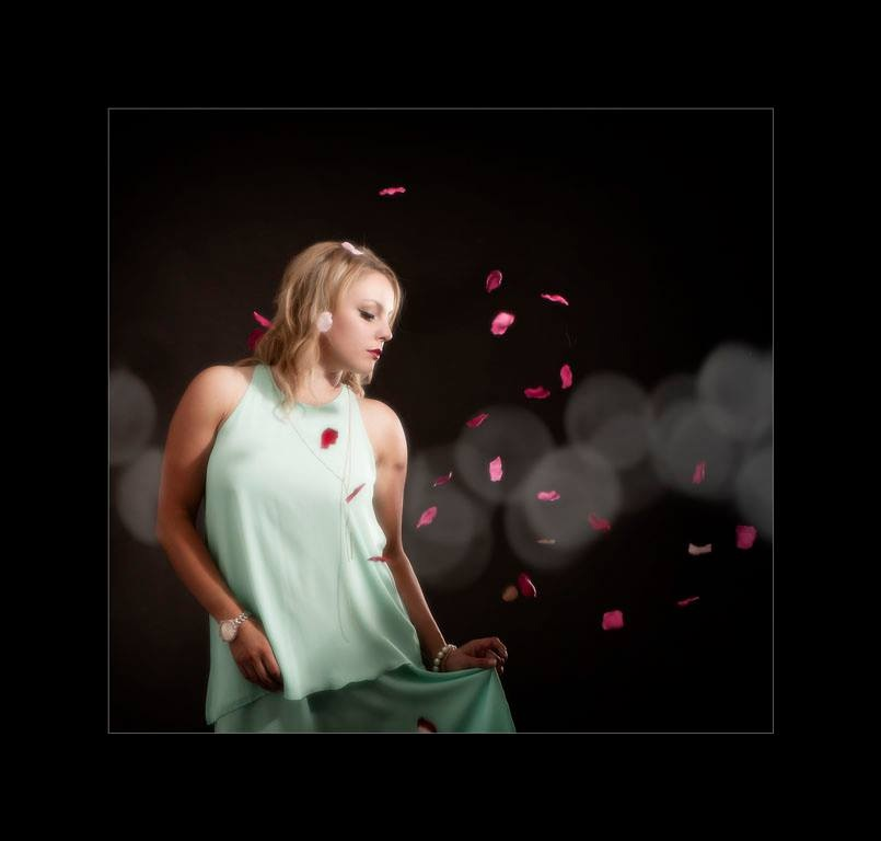 Photographers glasgow Girl in aqua dress with pink falling petals
