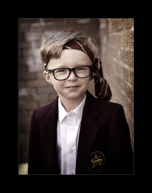 schoolboy with tie round his head