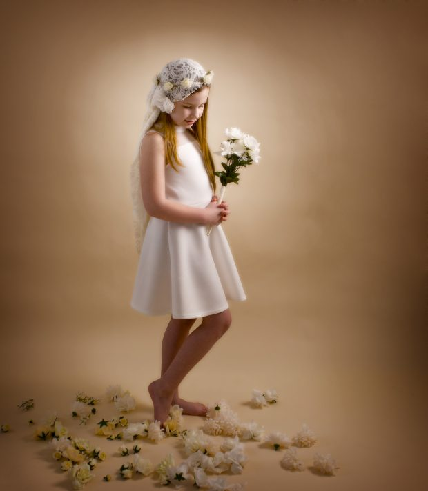 timeless young girl with flowers and cream dress