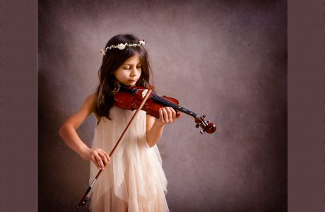 girl in tulle dress playing the violin
